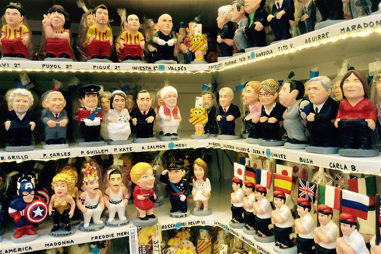 Some familiar faces take on the role of caganer at Christmas in Barcelona. Image by Sally Davies / Lonely Planet